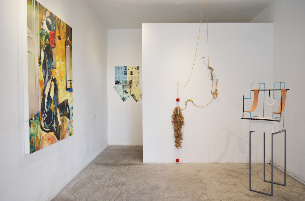 Installation shot of exhibition with three works