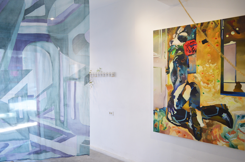 Installation shot with three artworks