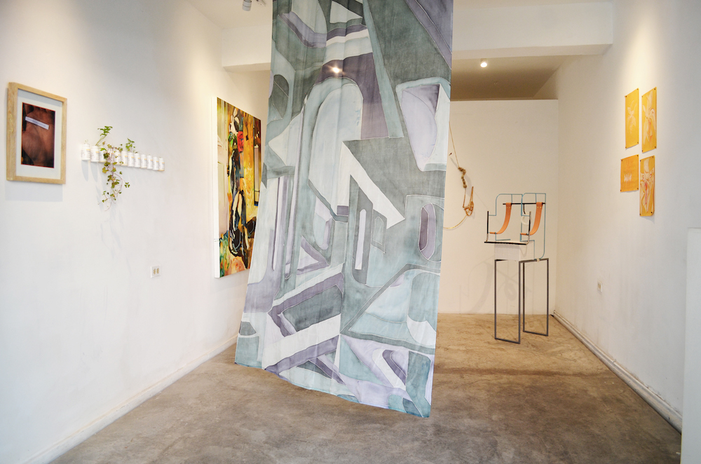 Installation shot with several artworks